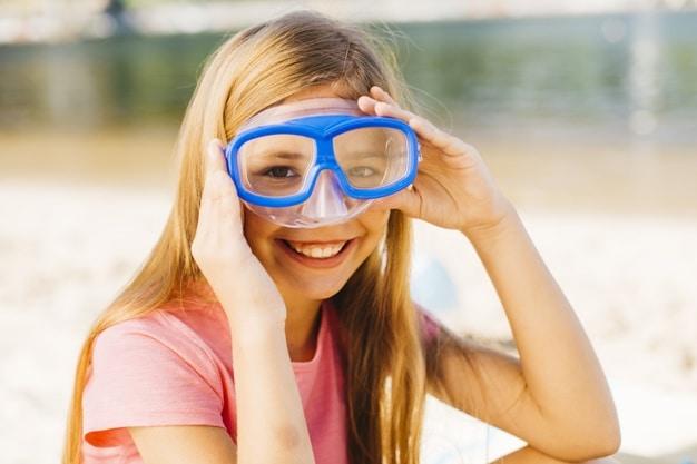 happy-girl-diving-mask-seaside_23-2148205807